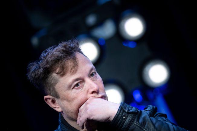 馬斯克今年3月在美國國際衛星通訊技術展及年會上聆聽問題。(Getty Images)