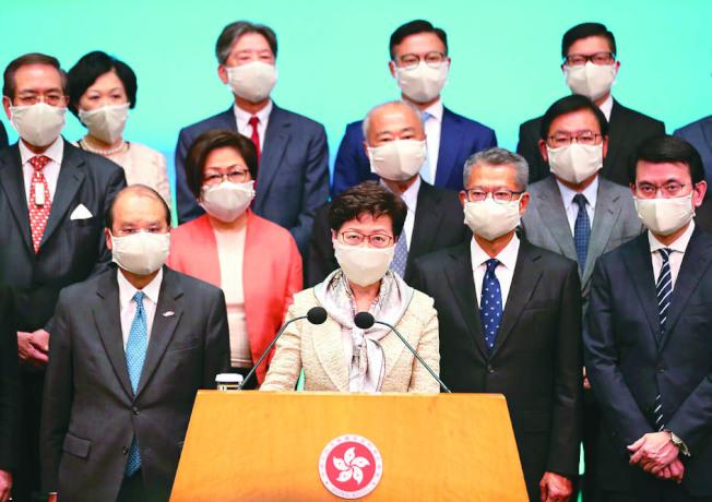 香港行政長官林鄭月娥22日會見傳媒時強調,建立健全香港特區維護國家安全的法律制度和執行機制,會保障香港居民合法權益和外國投資者利益。 (新華社)