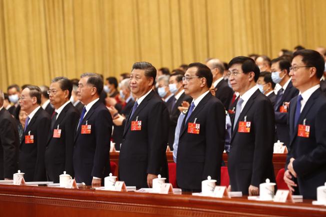 中國13屆全國人大三次會議25日在北京舉行第二次全體會議。中共中央政治局七常委習近平、李克強、栗戰書、汪洋、王滬寧、趙樂際、韓正等出席。(中新社)