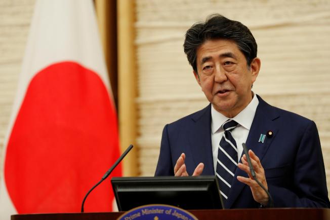 日本首相安倍晉三稱,新冠疫情從中國擴散至全球是事實。(路透)
