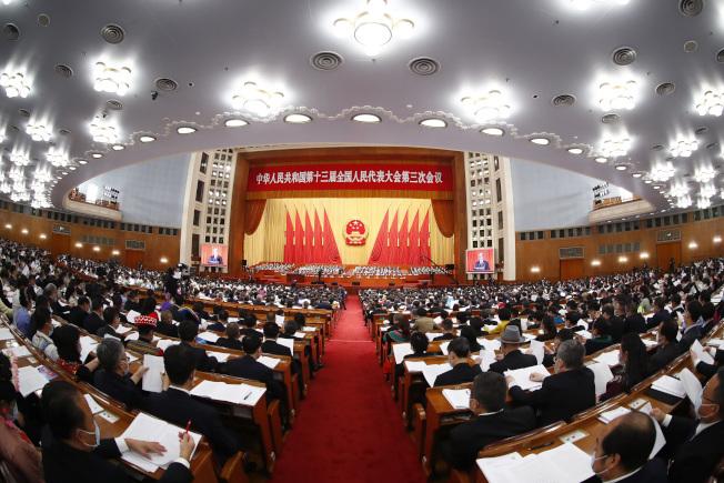 今年是自2002年以來,中國政府工作報告第一次沒有提出全年經濟增速具體目標。(中新社)