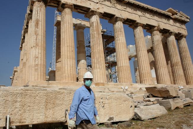希臘29日宣布,將於6月15日開放29個國家觀光客入境。圖為衛城。(歐新社)