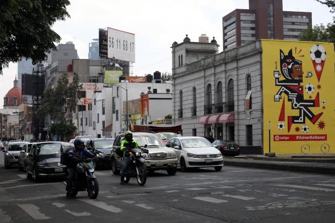美國新冠疫情再現警訊,把「墨西哥旅遊」列入原因。圖為墨西哥市一景。(歐新社)