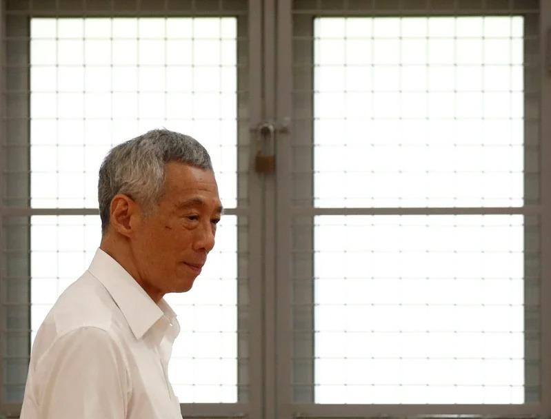 新加坡總理李顯龍準備針對提名發表演說。路透