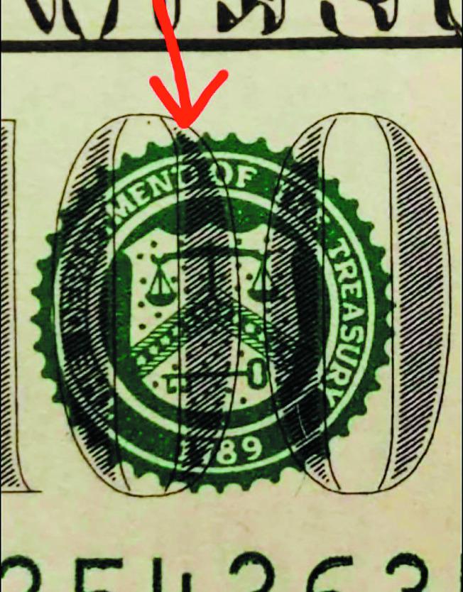 刑事局南打中心查獲一批舊版百元假美鈔,假美鈔上的「DEPARTMENT」錯拼為「DEPARTMEND」。(記者賴郁薇/翻攝)