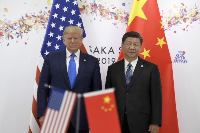 圖為2019年川普與習近平在大阪G20峰會見面。()