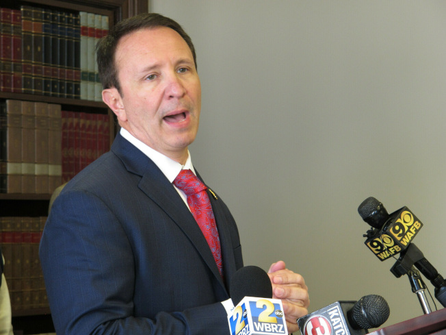 路易斯安納州檢察長蘭德瑞已染疫,他15日仍表示州長愛德華茲「強制戴口罩」的政策違反州憲且不得執行。(美聯社)