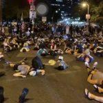 反暴警示威者平躺且林士果 華埠居民憂6月暴亂重來