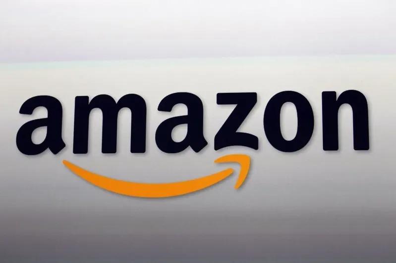 電子商務巨人亞馬遜有著微笑的企業標誌,但許多亞馬遜員工不堪工作負荷且對工作環境不滿,笑不出來。美聯社