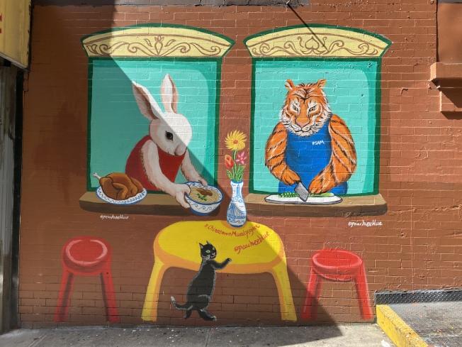 華人藝術家華埠手繪「麵條店」互動壁畫。(記者張晨/攝影)