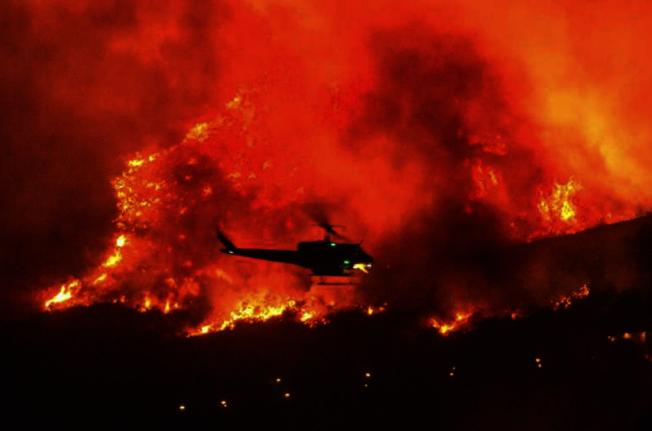 熱浪接連來襲,加州近日出現嚴重山火,空氣品質備受影響。(美聯社)